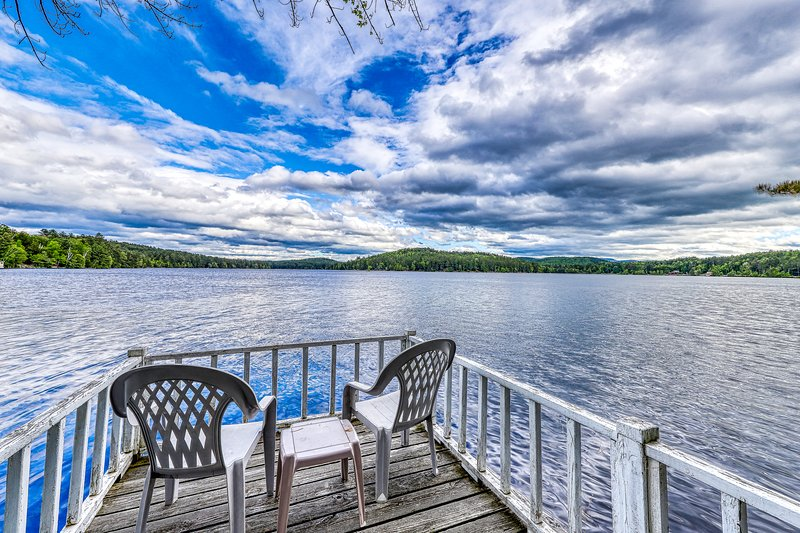 Lakefront cottage with screened gazebo, dock, 2 acres of space, holiday rental in Brant Lake