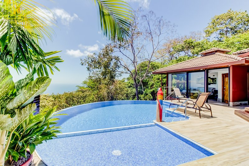 Hillside home w/ ocean view plus private pool, deck, outdoor kitchen & showers, vacation rental in Dominical