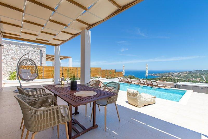 Amarillis Villa, coastal vistas, aluguéis de temporada em Kato Valsamonero