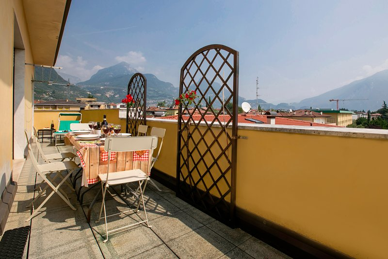 The balcony with view on the mountains and on the city
