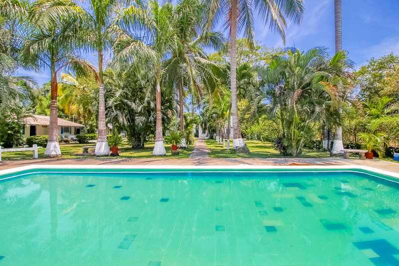 Villa at beachfront property with terrace & shared pool - steps to the sand!, vacation rental in Puntarenas