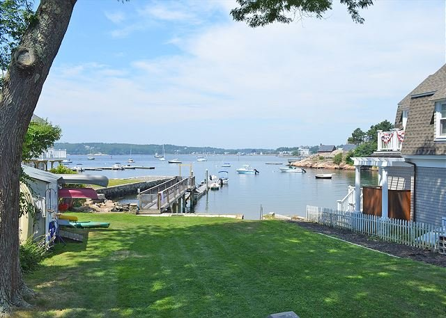 The backyard, the dock, and the cove beyond.