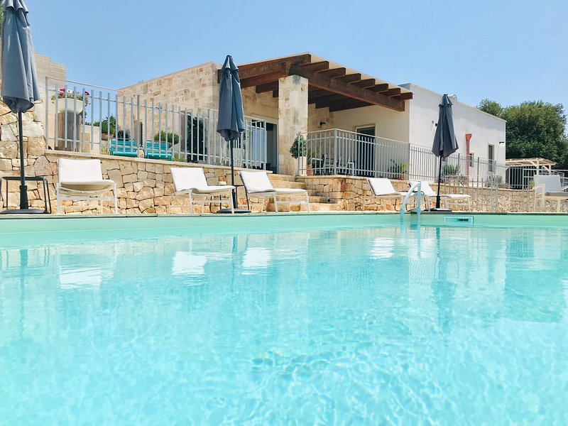 Luxury boutique ruustic-chic south facing trullo/villa with panoramic terraces and hilltop views.
