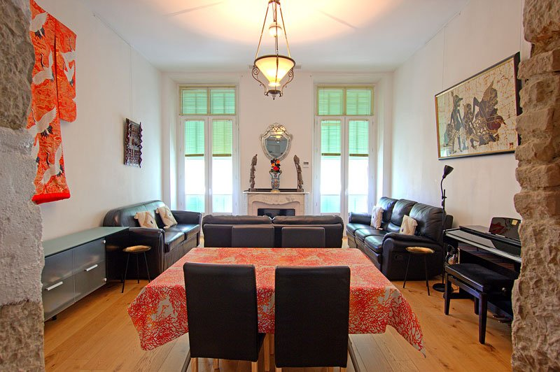 The living/dining room, air-con, extending table, 3 sofas, TV, balcony, piano and exotic artefacts!