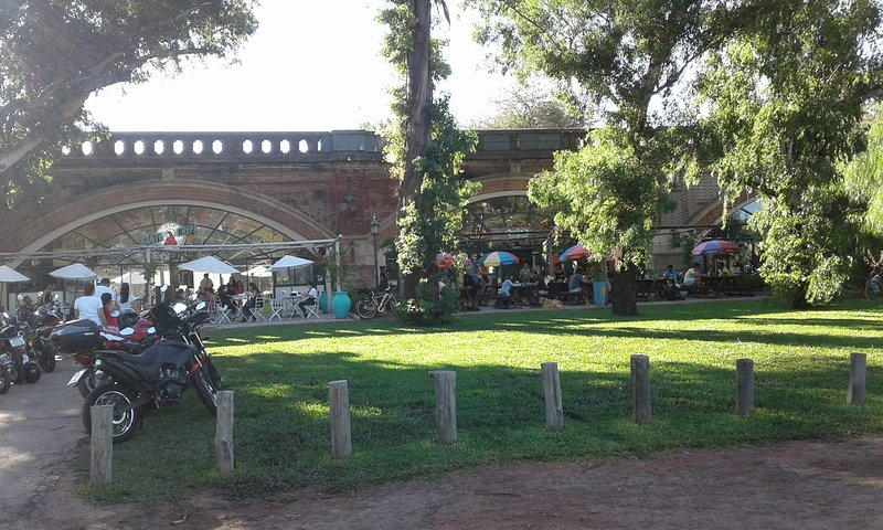 Paseo de la Infanta with its restaurants and bars under the old British-built  Arches of the railway