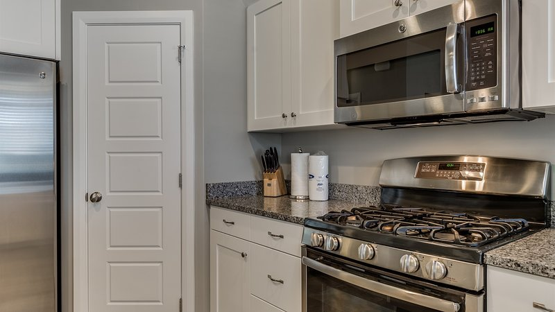 Fully stocked gourmet kitchen featuring stainless steel appliances
