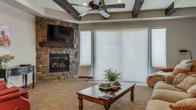 Large family room with comfortable seating featuring a fire place