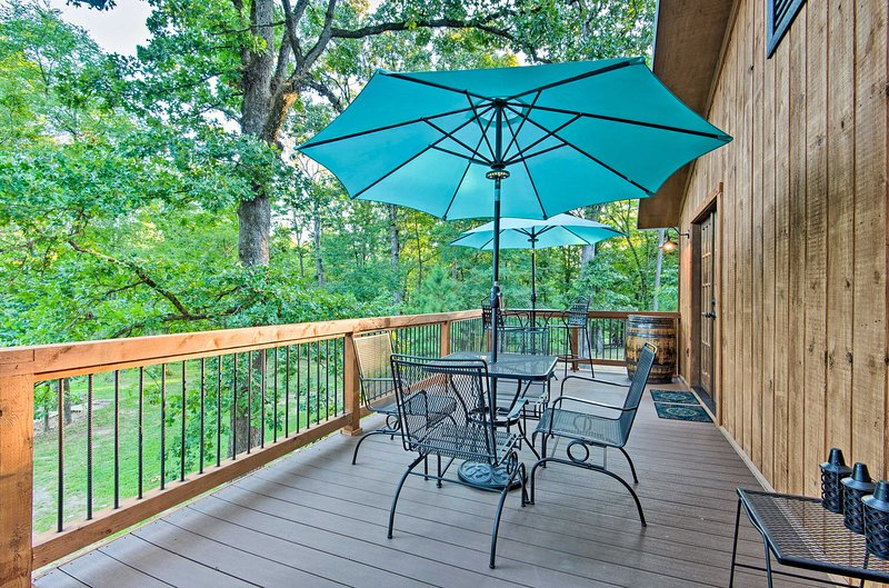 The vacation rental home has multiple outdoor living areas.