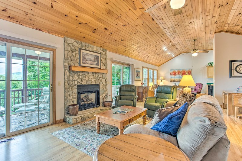 Snuggle up by the gas fireplace of this charming Maggie Valley cottage!