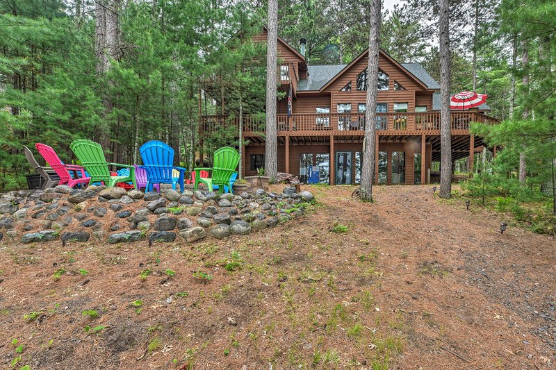 Your Up North escape awaits at this vacation rental cabin on Birch Island Lake!
