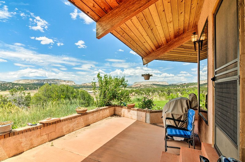 Enjoy views of the surrounding mesas from this hilltop property.