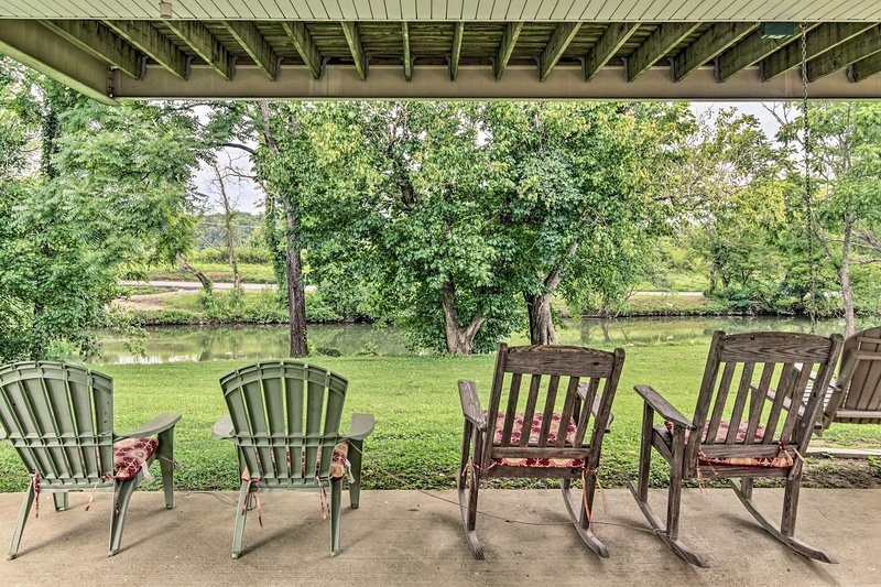 Enjoy the serenity of this riverside home just 1 mile from Pigeon Forge Parkway!