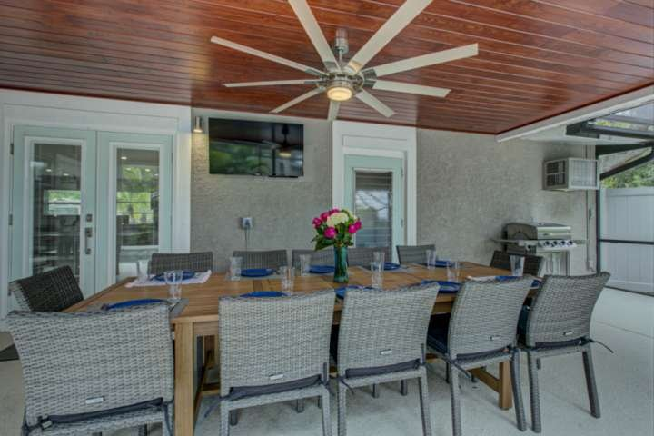 New outdoor dining table with 12 chairs so the whole gang can sit together.  TV and bbq grill too!