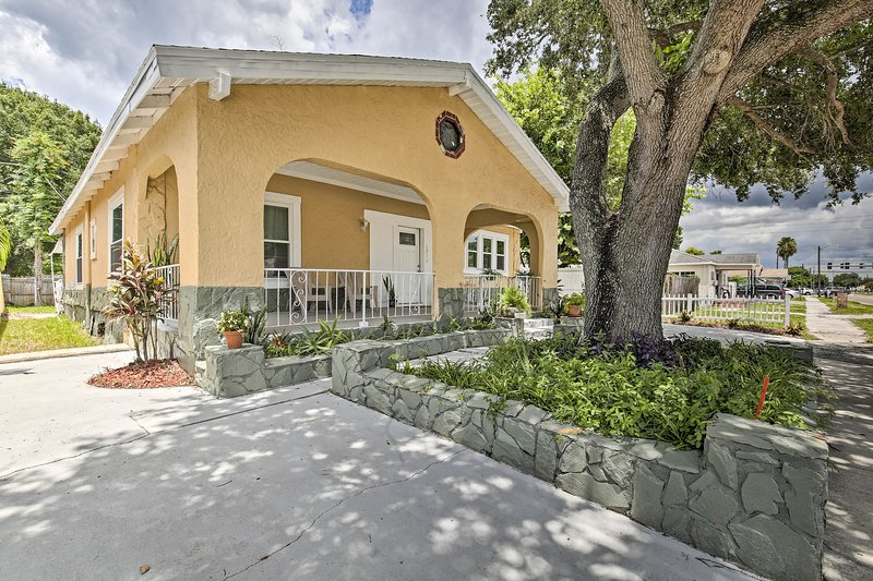 This house boasts a spacious backyard, charming front patio, and more!