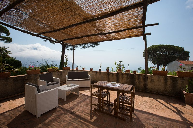 Private large terrace with sea view fournished with table, chairs and sofa