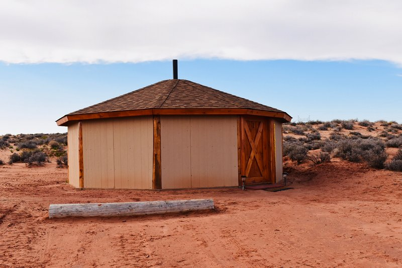exterior of the frontside of the Navajo Hogan with private parking