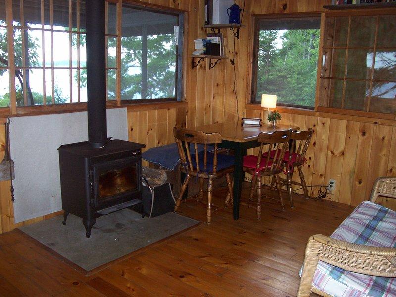 Cabin living room, ocean view through the window.