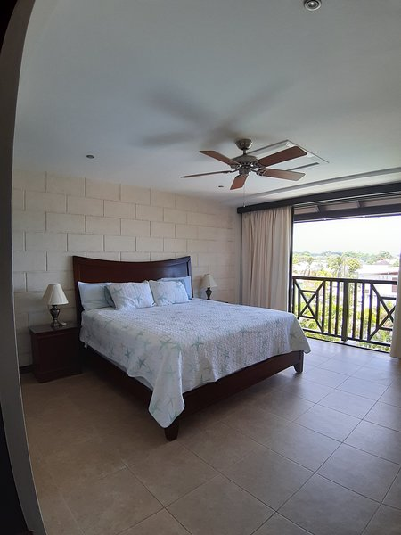 Super king size bed, full size sliding doors overlooking the pool