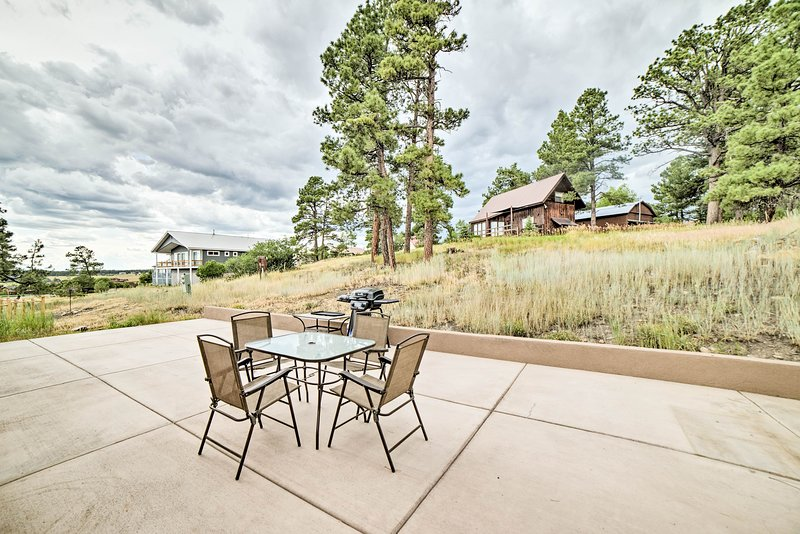 Dine outside in the mountain air during your stay at this vacation rental!