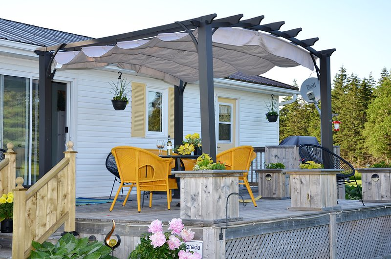 Waterfacing deck. Stunning waterview Pergola with retractable canopy.over dining area, BBQ on deck.