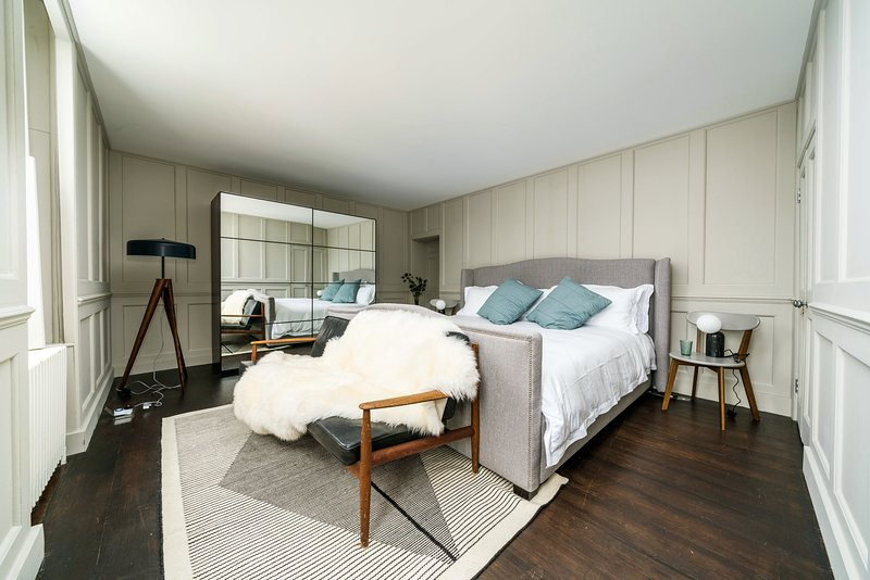 Master bedroom with incredible, huge emperor size bed.