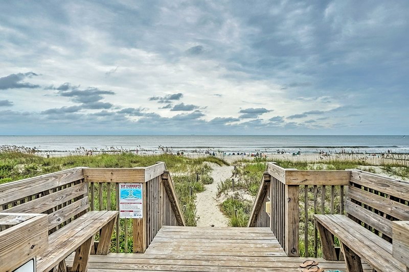 You'll be just a short walk from the Oak Island Beach.