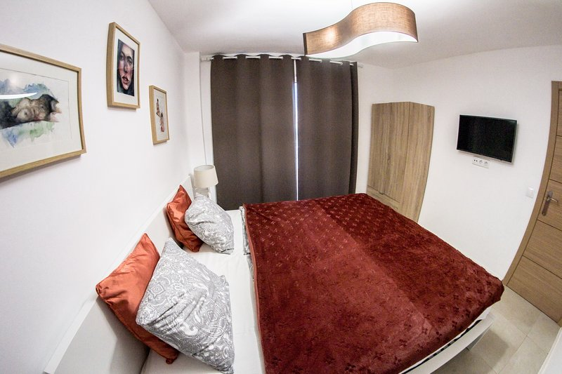 Master bedroom with smart tv.