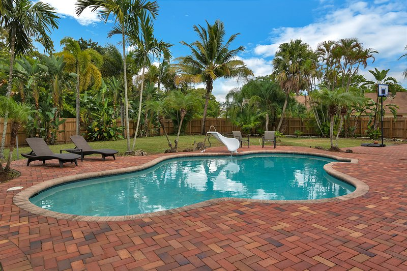 Relax and soak up the sun in this salt water pool in a huge private backyard.