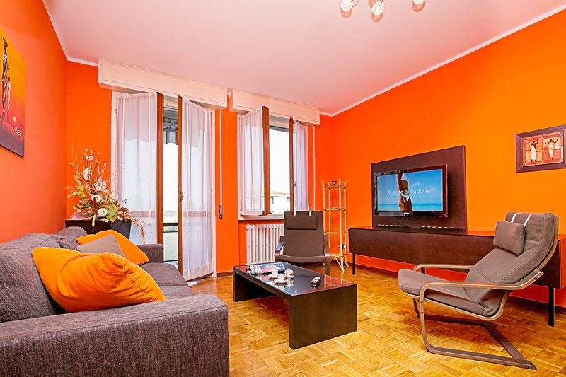 Bright and colourful modern living room with access to terrace