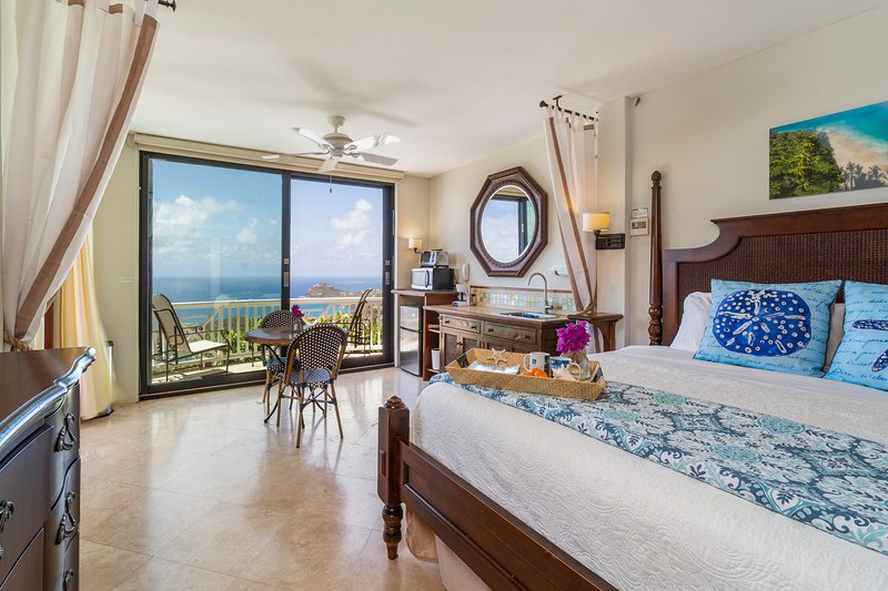 The spacious suite has an ultra comfy bed; fabulous panoramic ocean views.
