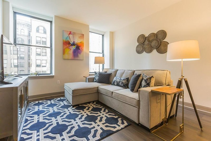 Modern, spacious home located steps from the Avenue of the Arts. This home offers two bedrooms and one bathroom as well as a sleeper sofa in the living room for additional guests. The location couldn't be better, step outside and you'll be in Vibran...