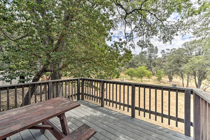 Breathe in fresh air on the back deck from this Foresthill home!