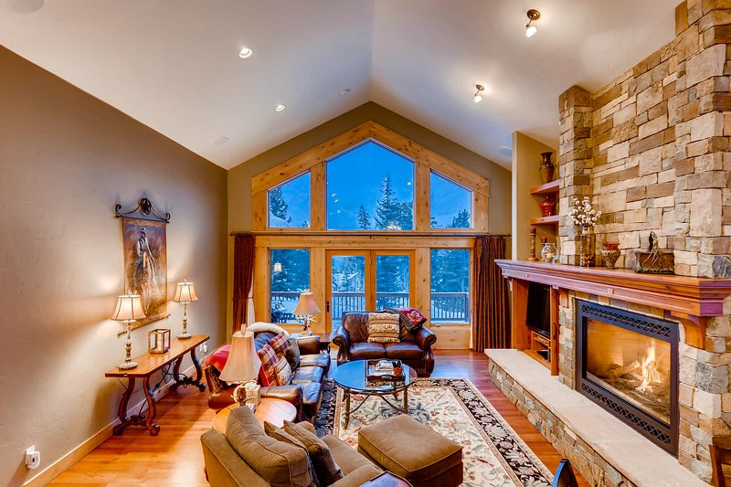Spacious living room with plenty of comfy seating for the whole family!