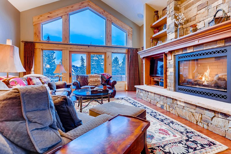 Main level living room with flat screen TV and gas fireplace