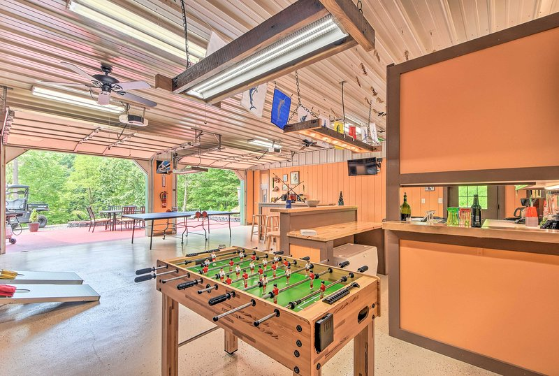 This vacation rental offers incredible amenities like this decked-out game room.