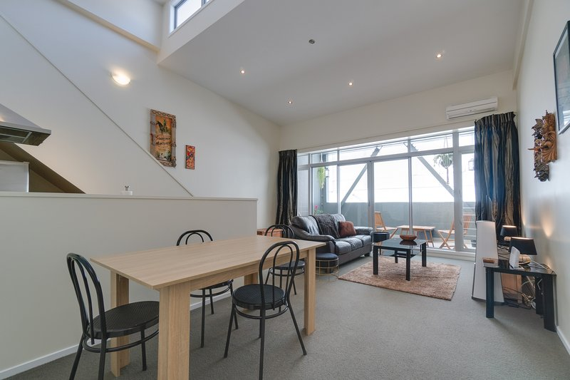 A decent sized dining table which over looks the living area and backs onto the kitchen