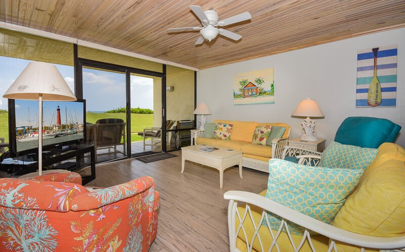 Decorated with Florida style this direct oceanfront living room features a flat screen TV, DVD, recliner and sofa sleeper.
