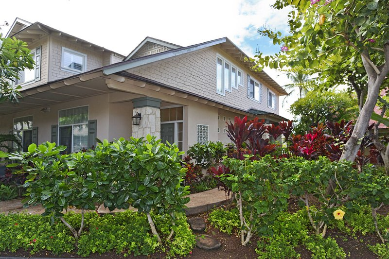 Outdoor picture of this Oahu condo and its colorful island landscaping.