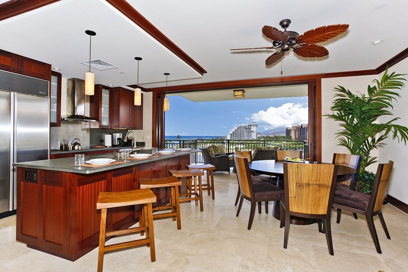 Large Pocket Doors in the kitchen of this Ko Olina beach villa in Hawaii open to the Lanai.