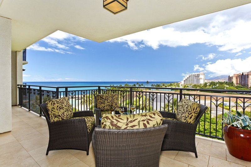 Enjoy beautiful sunsets over the Pacific blue from the lanai of this Ko Olina beach villa in Hawaii!