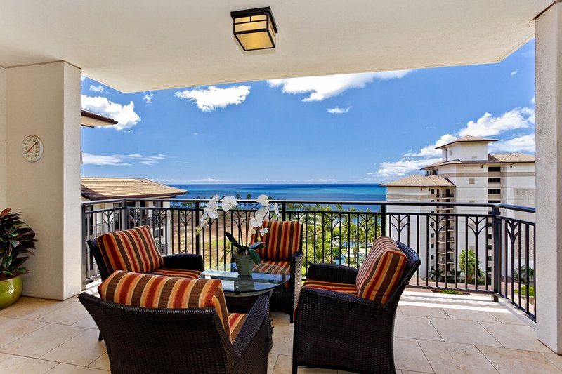 Big Balcony with Ocean View, Outdoor Chairs, and Coffee Table.