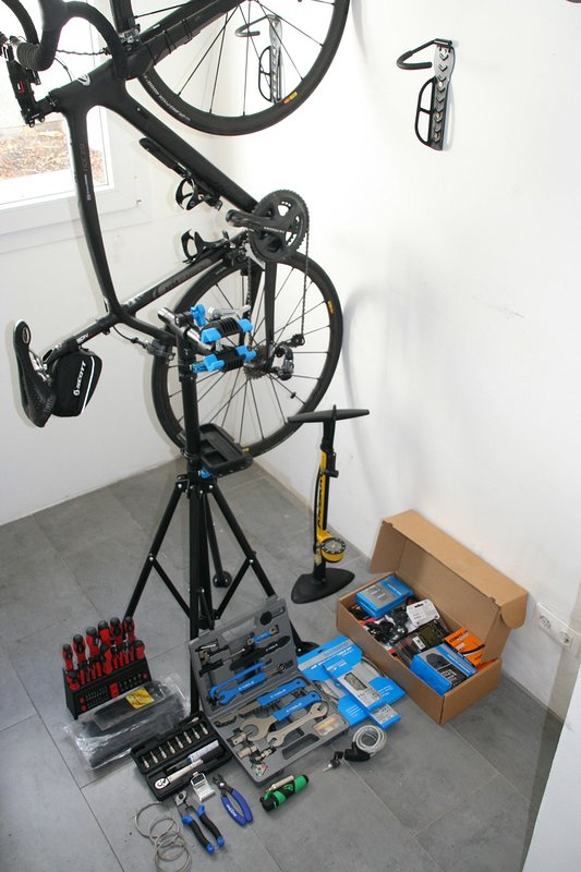 Well equipped secure bike room with a range of tools including workstand, trackpump and CO2