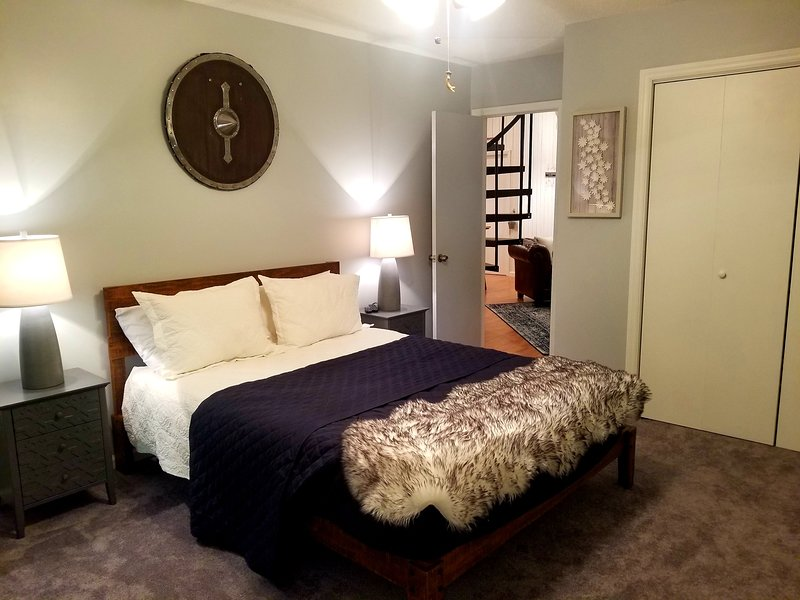 Bedroom with queen bed, TV with streaming services and attached bathroom. Has access to the deck.
