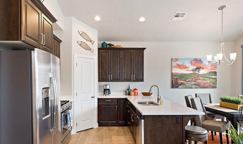 Cucina gourmet completamente fornita con tutti i comfort di casa
