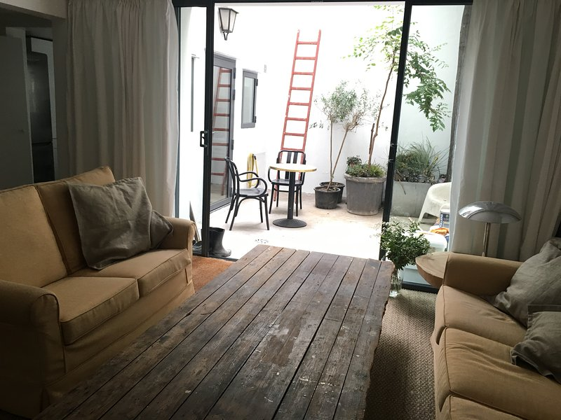 Living room with direct access to the private patio