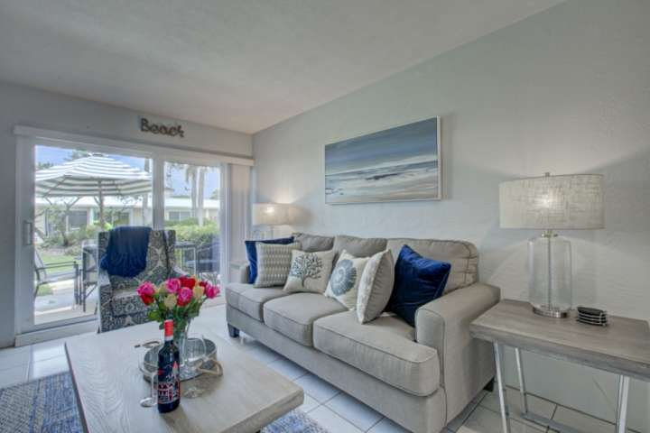 Living room is comfy with new furniture.  Beautiful gray sofa queen sleeper with blue accents