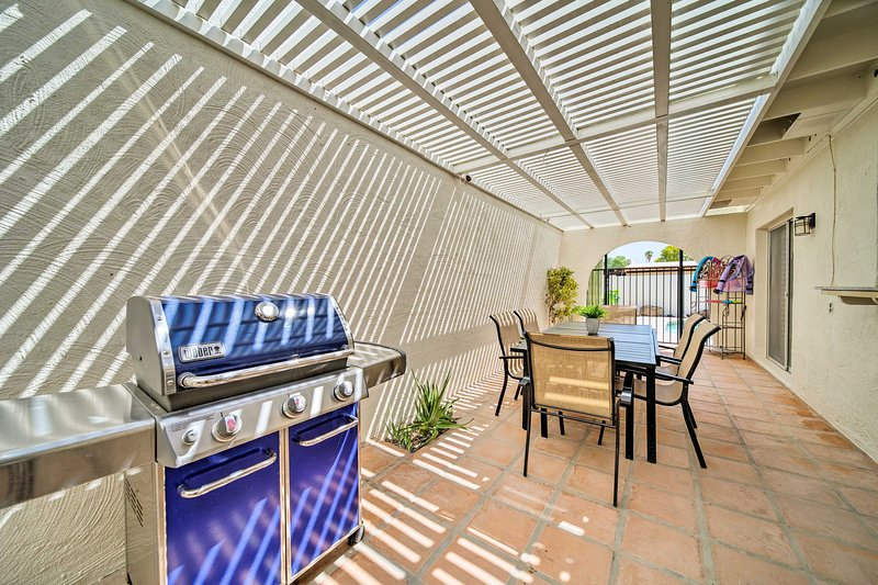 This Litchfield Park home offers a pool, patio, grill, and much more!