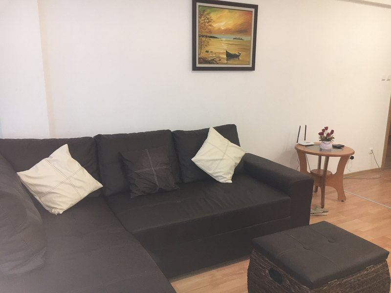 King sized leather sofa bed, cushions & foot stool.