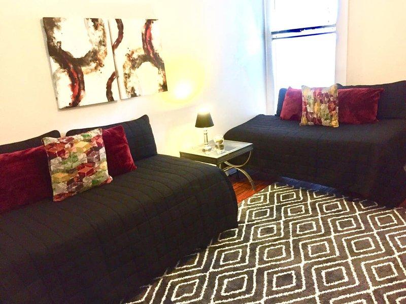 Il soggiorno ha 2 morbidi letti gemelli che sono divani di giorno e comodi per dormire la notte!