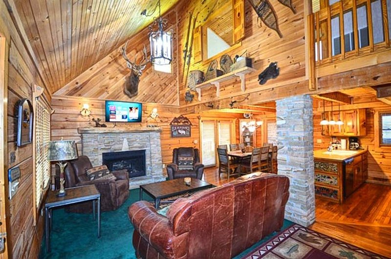 Main living area with gas fireplace & TV